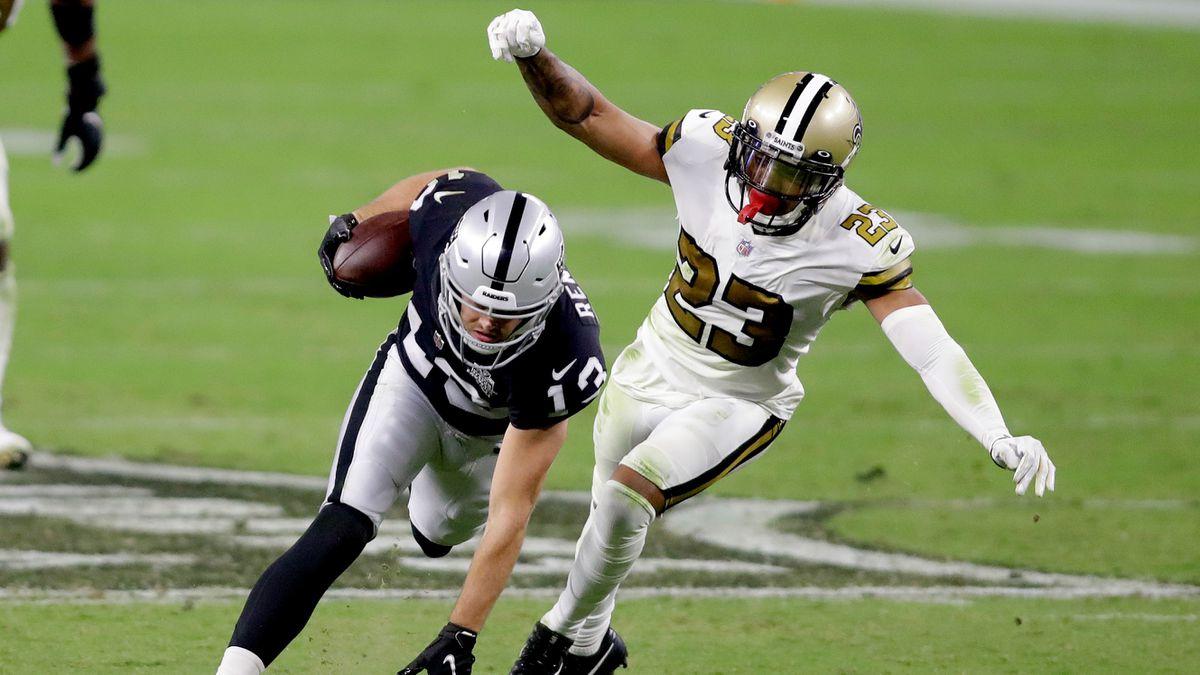 New Orleans Saints cornerback Marshon Lattimore (23) tackles Las Vegas Raiders wide receiver...