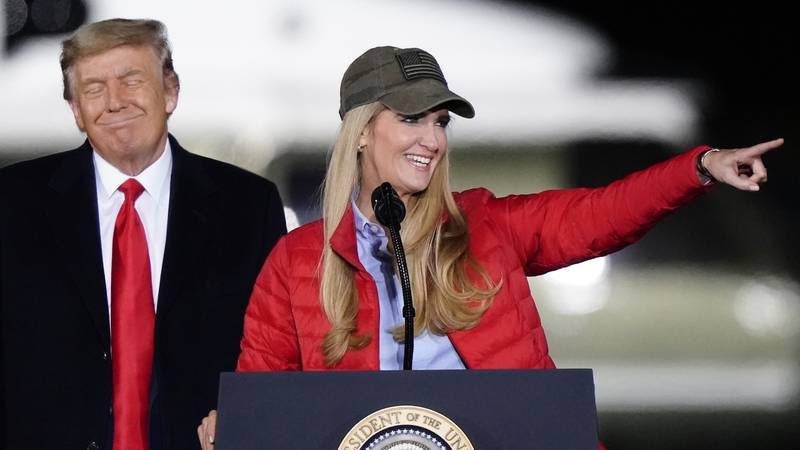 Sen. Kelly Loeffler, R-Ga., speaks as President Donald Trump listens during a campaign rally in...
