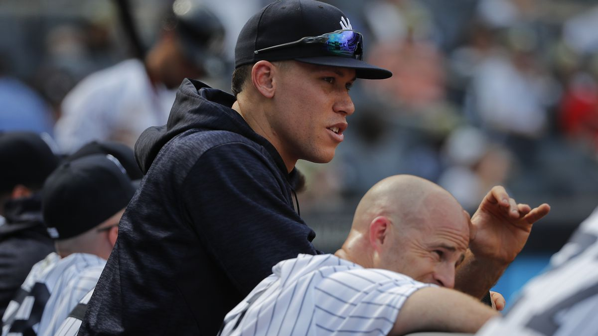 New York Yankees' Aaron Judge, left, and Brett Gardner watch from the dugout during the ninth inning of a baseball game against the Kansas City Royals, Saturday, July 28, 2018, in New York. (AP Photo/Julie Jacobson)