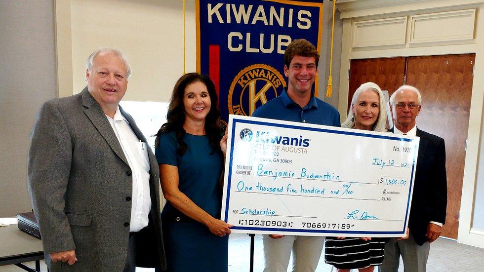From left: Daniel Rogers, Scout executive; Martha Ginn, Kiwanis president, Benjamin Budenstein;...