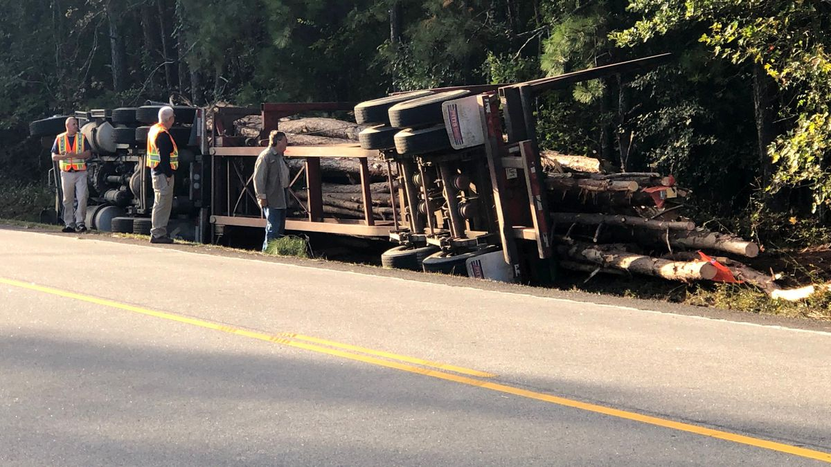A logging truck rests in its side along Martintown Road just inside Edgefield County on Oct,...