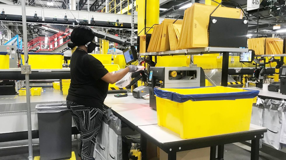 Hundreds of employees will work alongside Amazon robotics equipment at the new distribution...
