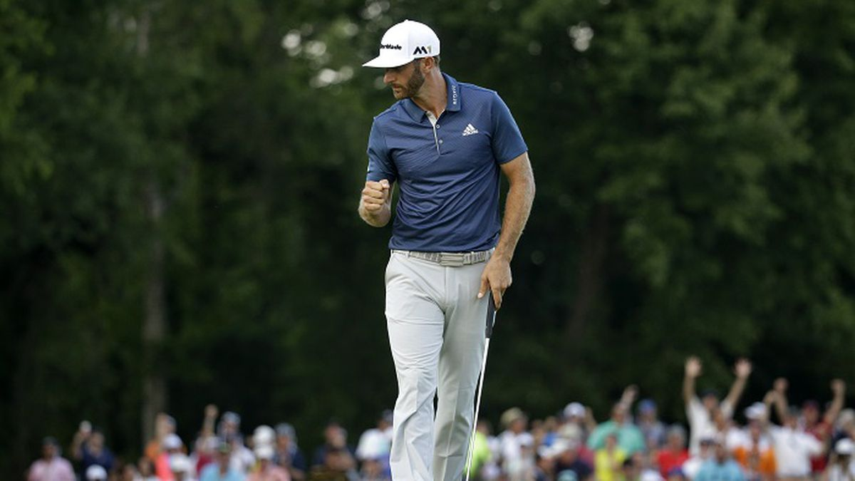 Dustin Johnson celebrates on the 15th hole during the final round of the U.S. Open golf championship at Oakmont Country Club on Sunday, June 19, 2016, in Oakmont, Pa. (AP Photo/John Minchillo)