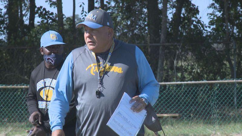 Head coach Brian Smith watches as the Ridge Spring-Monetta Trojans go through practice.