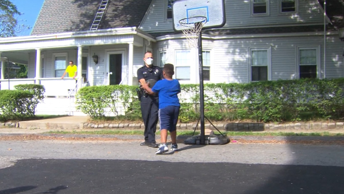 A Massachusetts police officer plays an impromptu basketball game with a 6-year-old. (Source: CNN, WBZ)