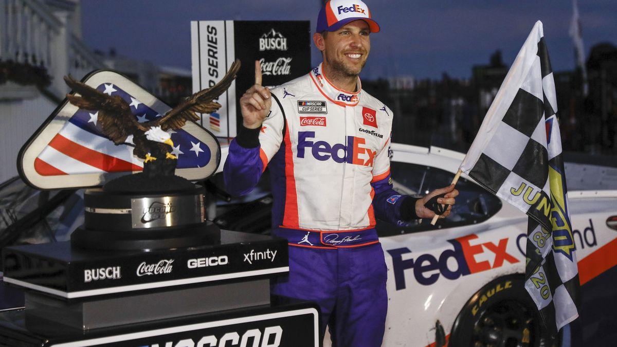 Denny Hamlin smiles after winning the NASCAR Cup Series auto race at Pocono Raceway, Sunday, June 28, 2020, in Long Pond, Pa. (AP Photo/Matt Slocum)