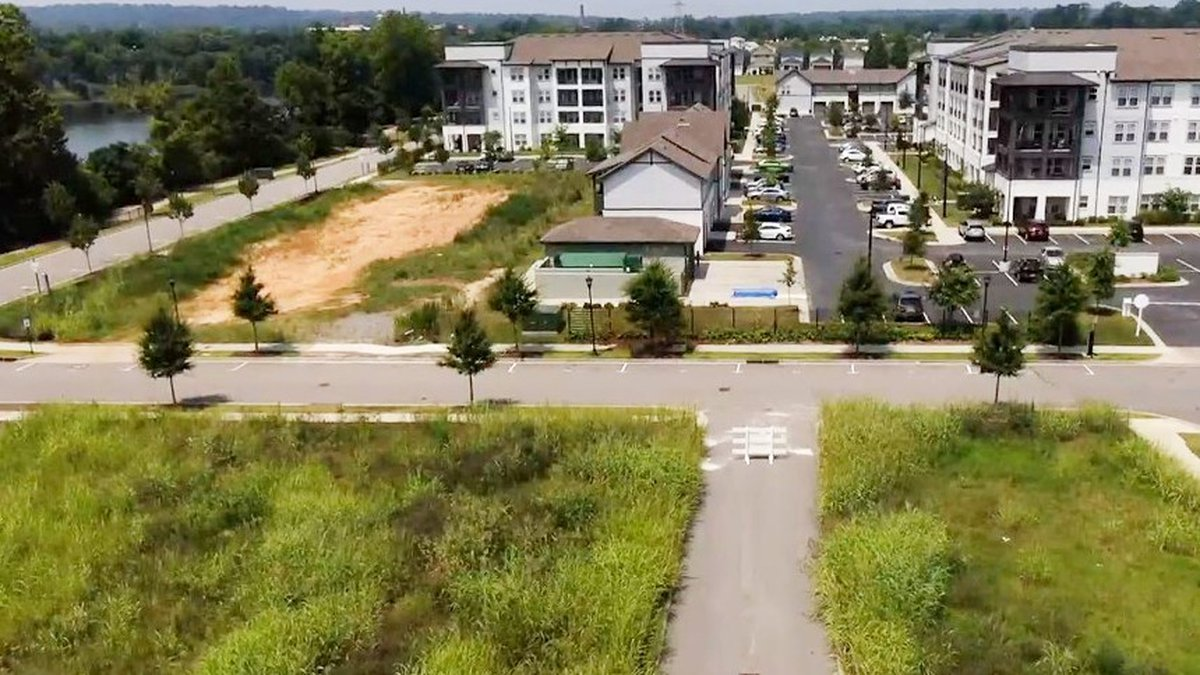 A deal between the bank and developer have saved six empty lots in Riverside Village from being...