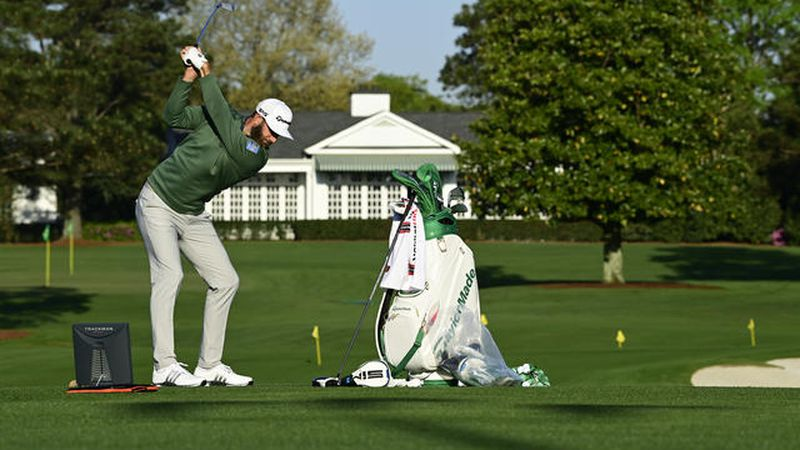 Masters champion Dustin Johnson prepares on the Tournament Practice Facility during Practice...