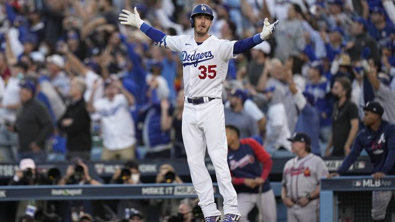 Los Angeles Dodgers center fielder Cody Bellinger reacts after hitting a three-run home run...