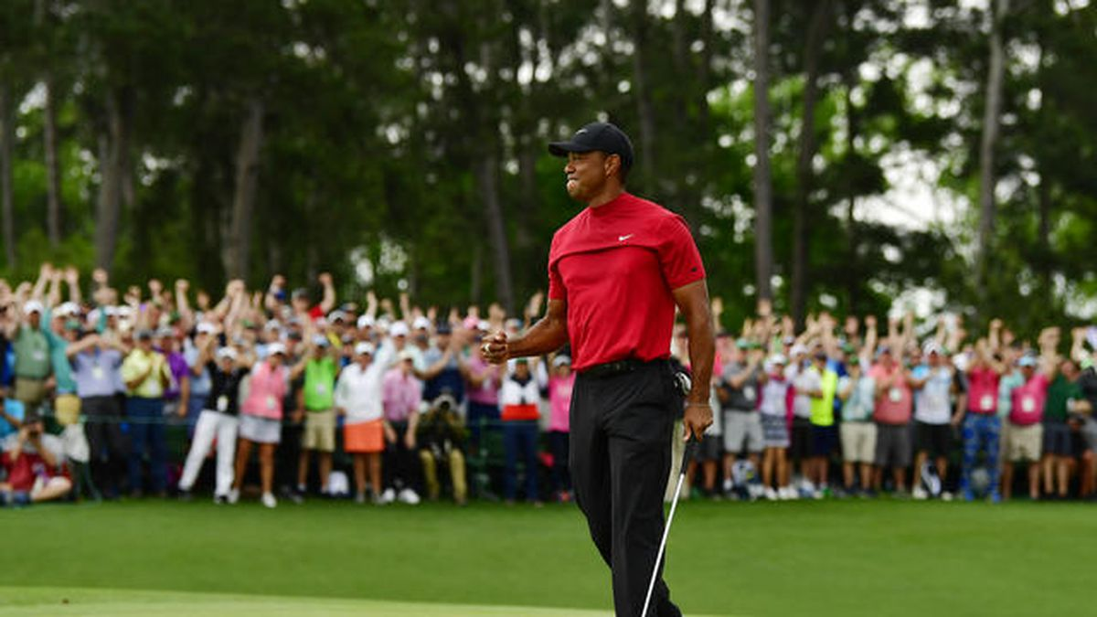Masters champion Tiger Woods celebrates on the No. 18 green after winning the Masters at Augusta National Golf Club, Sunday, April 14, 2019.(Source: Augusta National Golf Club)