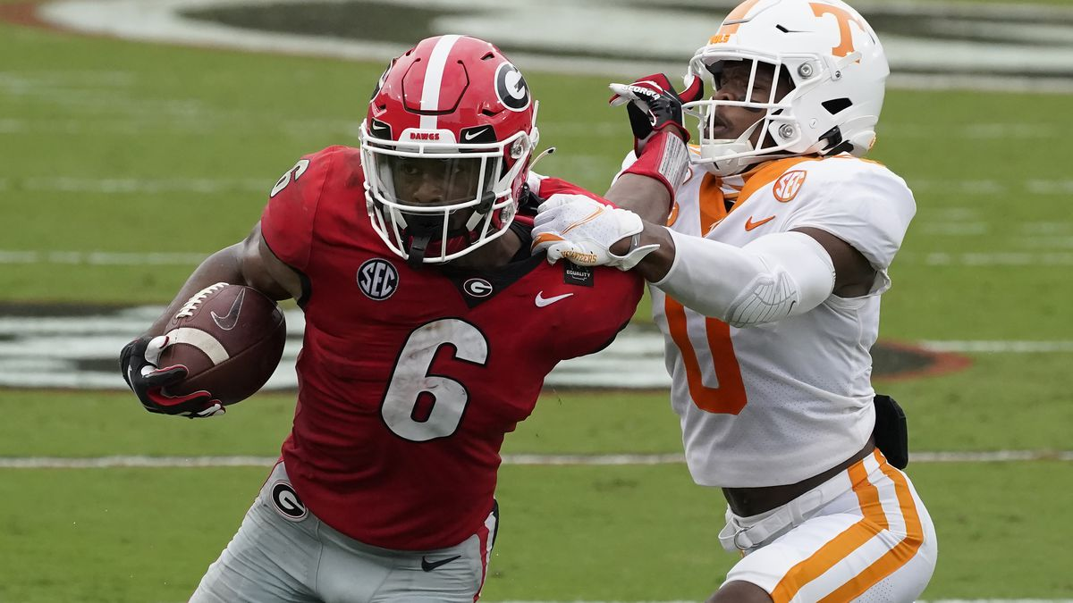 Georgia running back Kenny McIntosh (6) tries to fend off Tennessee defensive back Bryce Thompson (0) in the first half of an NCAA college football game Saturday, Oct. 10, 2020, in Athens, Ga. (AP Photo/John Bazemore)