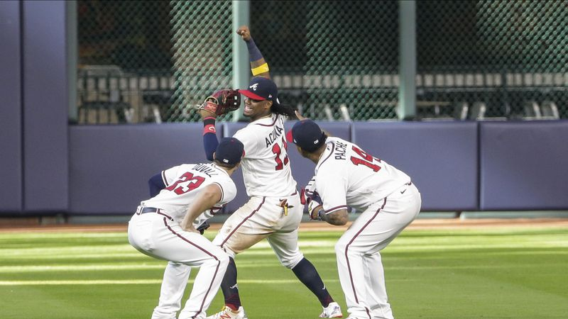 Braves outfielder celebrate after a win over the Marlins in Game 1 of the NLDS on Tuesday