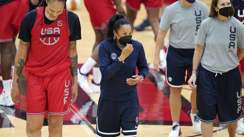 FILE - In this July 13, 2021, file photo, head coach Dawn Staley, center, coaches during...