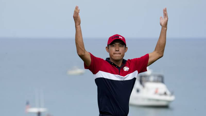 Team USA's Collin Morikawa reacts after winning the 17th hole during a Ryder Cup singles match...