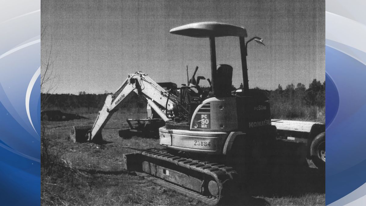 This is a scan of a photo of the mini-excavator that the city alleges an employee used on...