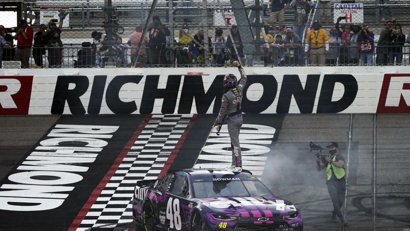 Alex Bowman (48) stands on his car as he celebrates after winning a NASCAR Cup Series auto race...