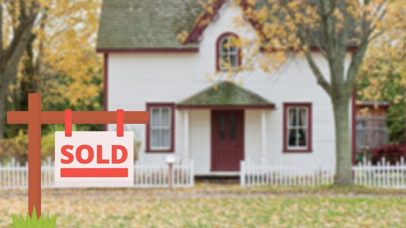 A home for sale with a sold sign graphic out front.