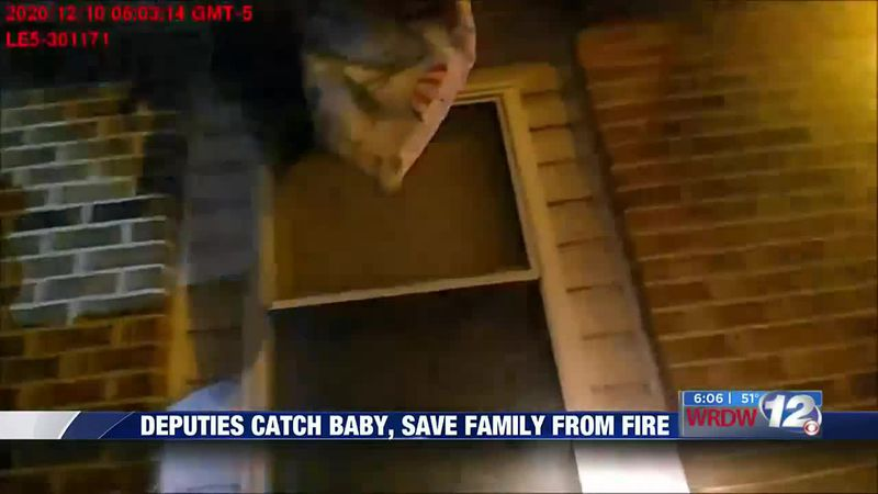 Deputies catch baby, save family from fire