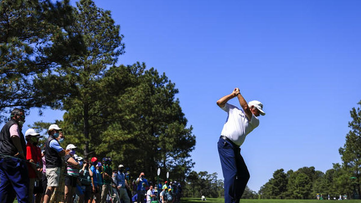 Masters champion Fred Couples plays a stroke from the No. 15 tee during Practice Round 1 for...