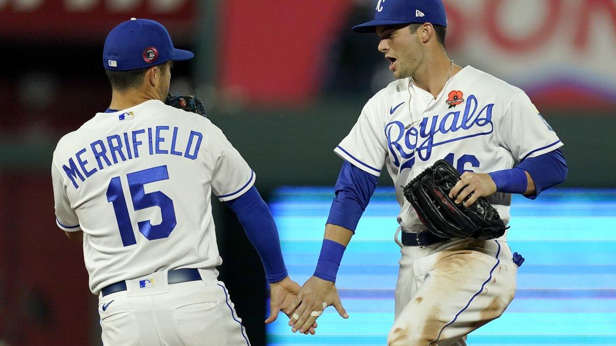Kansas City Royals' Whit Merrifield (15) and Andrew Benintendi celebrate after their baseball...