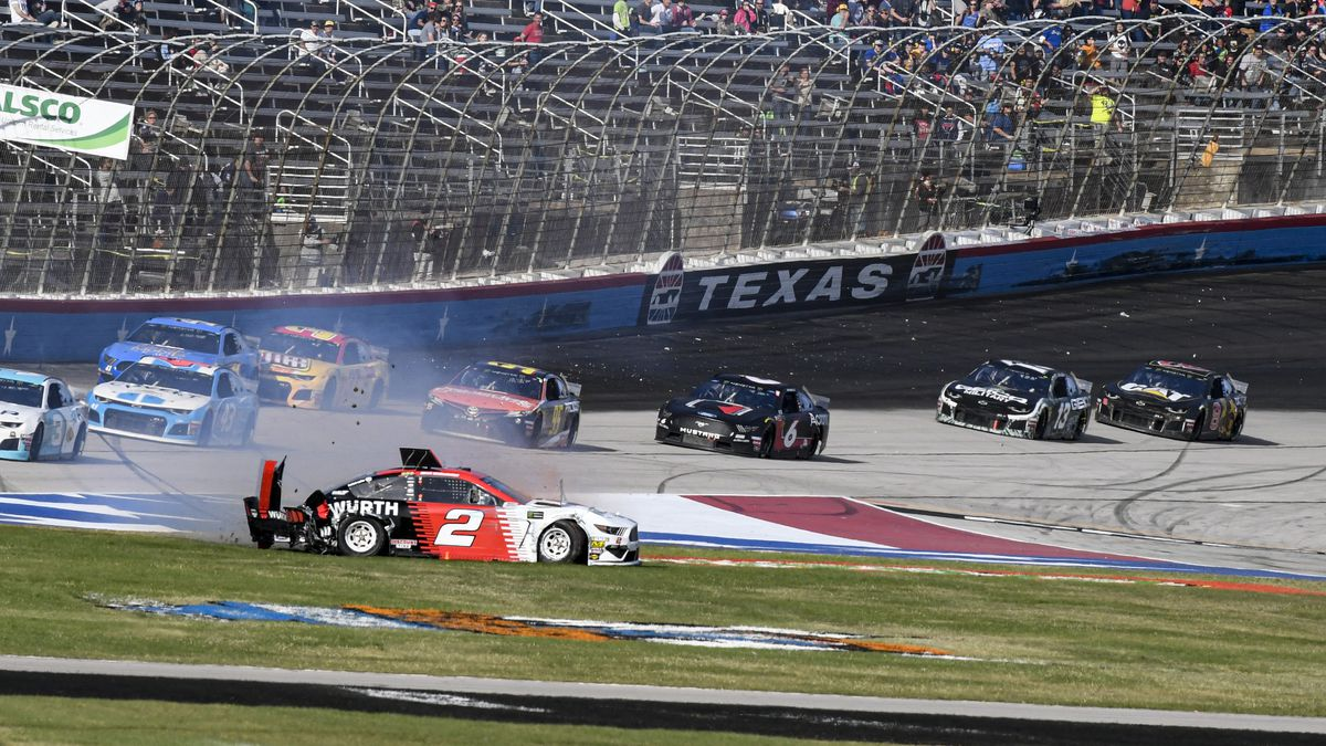 Brad Keselowski (2) wrecks into the grass on the front stretch during a NASCAR auto race at...