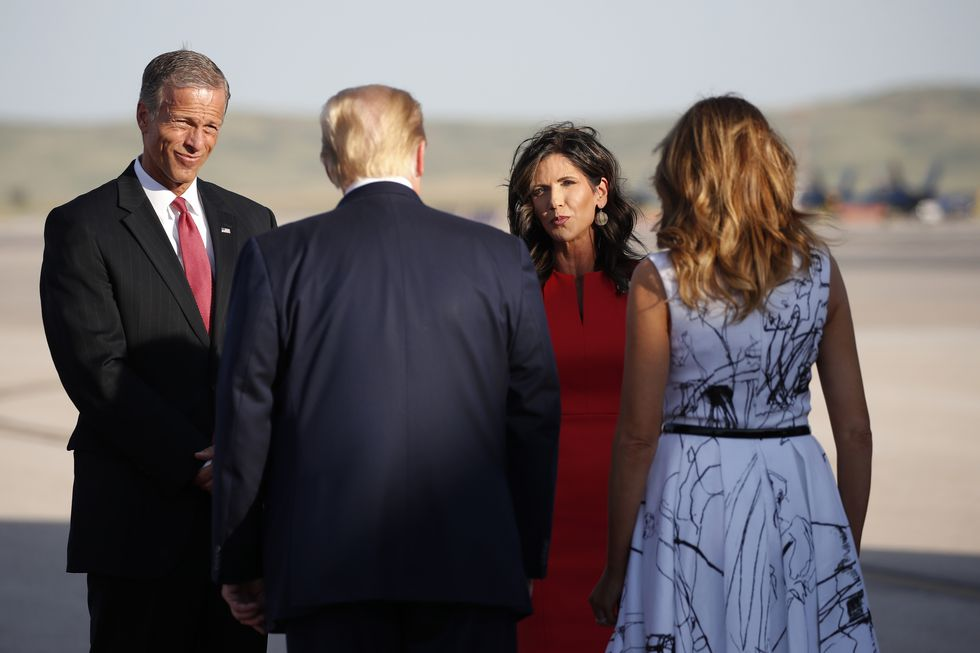 Sen. John Thune, R-S.D., and Gov. Kristi Noem greet President Donald Trump and first Lady Melania Trump upon arrival at Ellsworth Air Force Base, Friday, July 3, 2020, in Rapid City, S.D. Trump is en route to Mount Rushmore National Memorial.