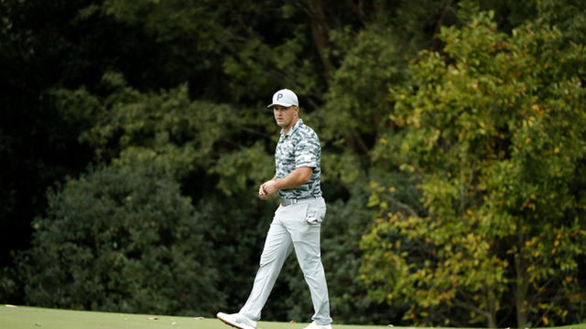 Bryson DeChambeau walks on the No. 5 green during Practice Round 1 for the Masters at Augusta...