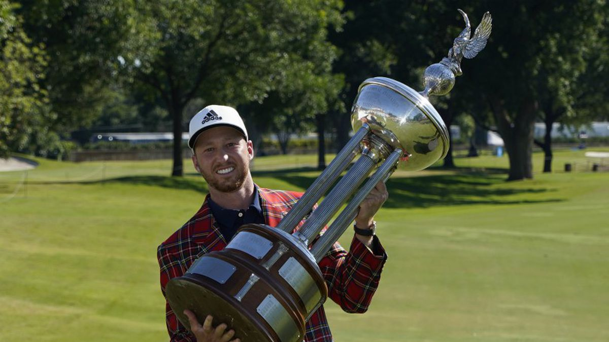 Daniel Berger poses with the championship trophy after winning the Charles Schwab Challenge...