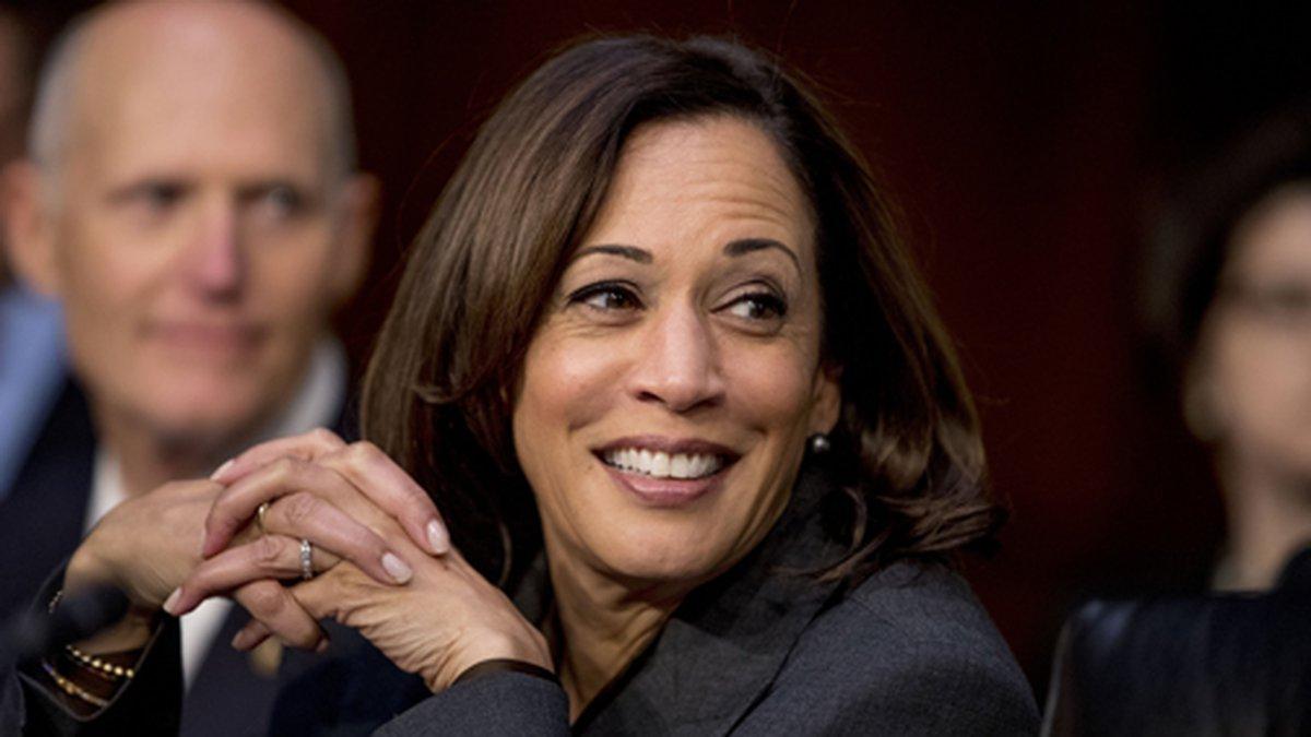 Democratic presidential candidate Sen. Kamala Harris, D-Calif., right, and Sen. Rick Scott,...