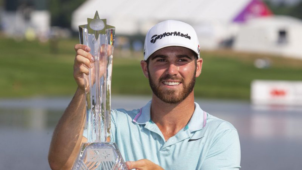 Matthew Wolff holds the trophy after winning the 3M Open golf tournament Sunday, July 7, 2019,...