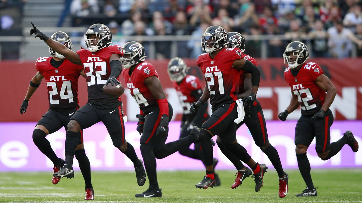 Atlanta Falcons safety Jaylinn Hawkins (32) celebrates making an interception during the first...