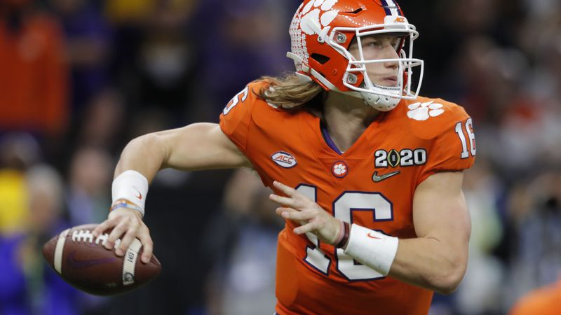FILE - In this Jan. 13, 2020, file photo, Clemson quarterback Trevor Lawrence passes against...