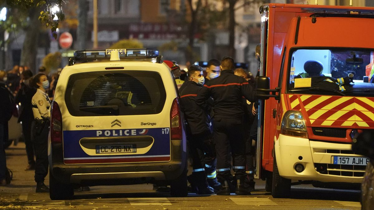 Police officers and rescue workers block the access to the scene after a Greek Orthodox priest...