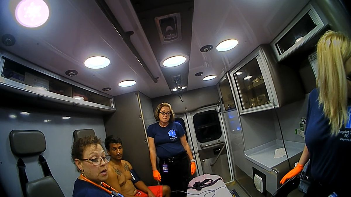 Paul Tarashuck, pictured here inside an ambulance without a shirt on, was being treated on Interstate 95 just hours before he died while walking on the interstate.