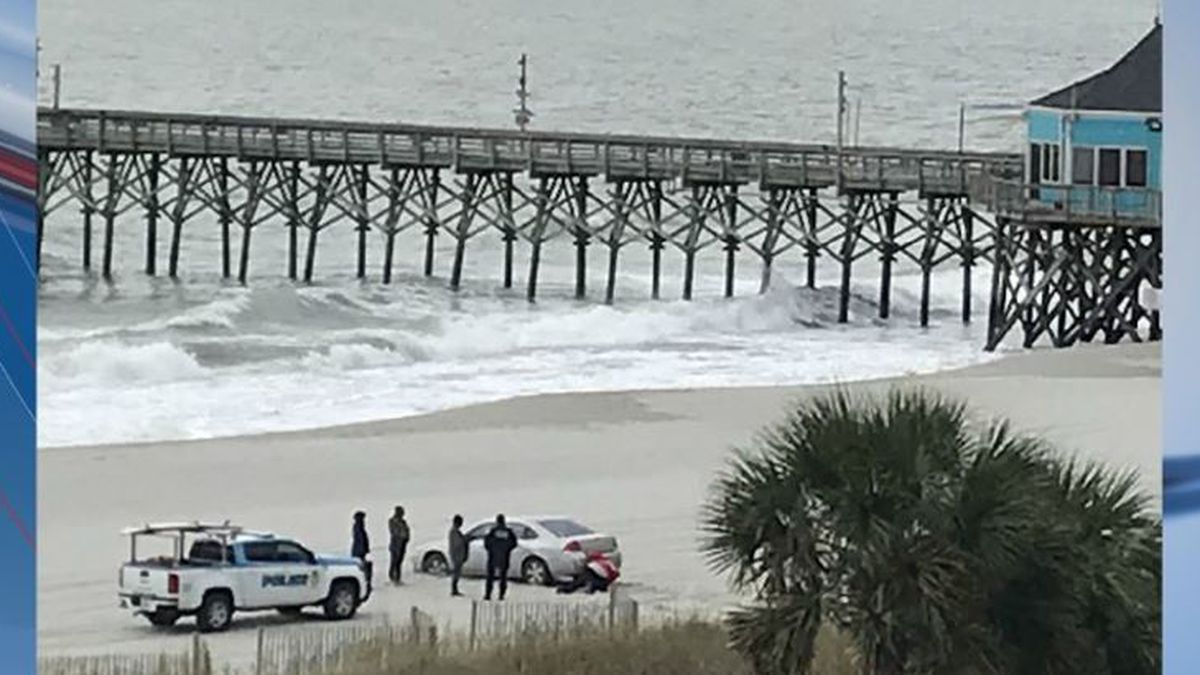 Just months after an abandoned Jeep captivated many during Hurricane Dorian, another vehicle got caught in the sand Thursday morning in Myrtle Beach. (Source: Viewer-submitted photo)