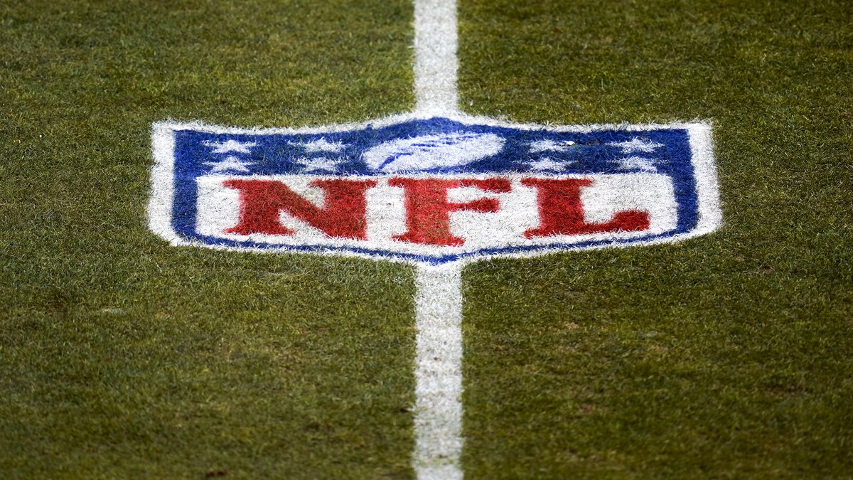 FILE - This Jan. 3, 2021, file photo, shows the NFL logo on the field before an NFL football...