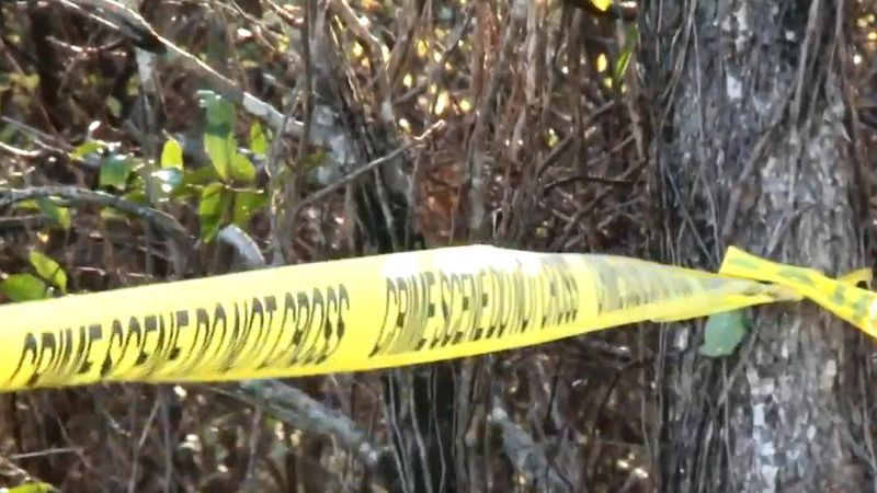 Crime scene tape was hung around the site where a body was found in a field outside Johnston.