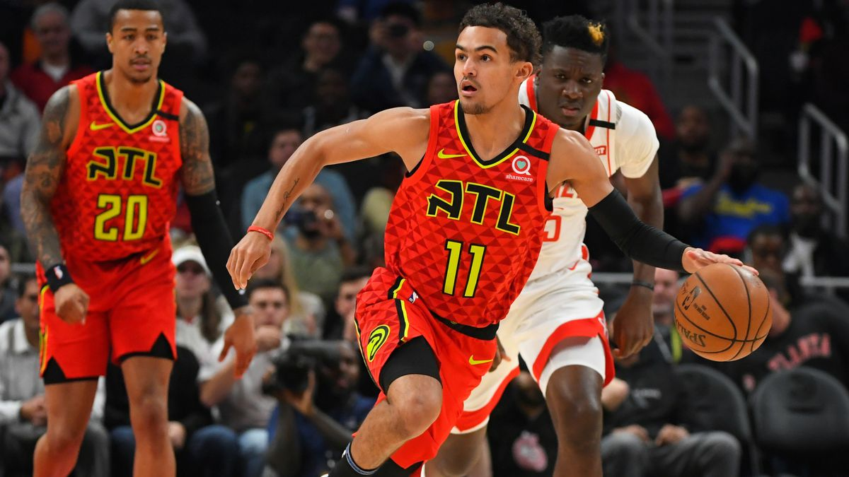 Atlanta Hawks guard Trae Young (11) races upcourt during the first half of an NBA basketball...