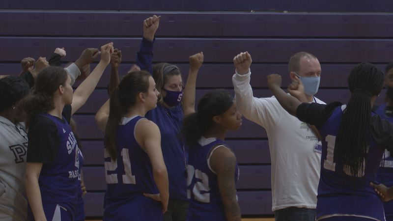 Saluda head coach Jeanette Wilder breaks down the huddle as the Tigers prepare for practice...