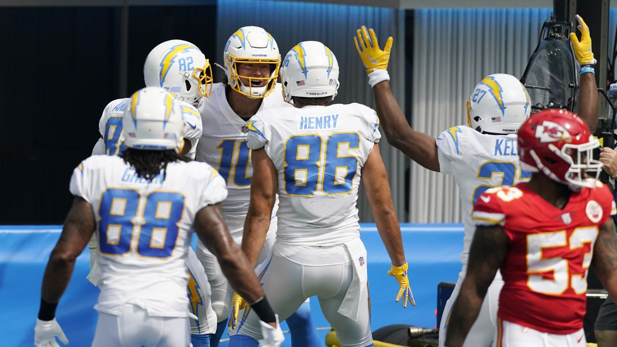 Los Angeles Chargers quarterback Justin Herbert (10) celebrates with teammates after scoring a rushing touchdown against the Kansas City Chiefs during the first half of an NFL football game Sunday, Sept. 20, 2020, in Inglewood, Calif. (AP Photo/Ashley Landis)