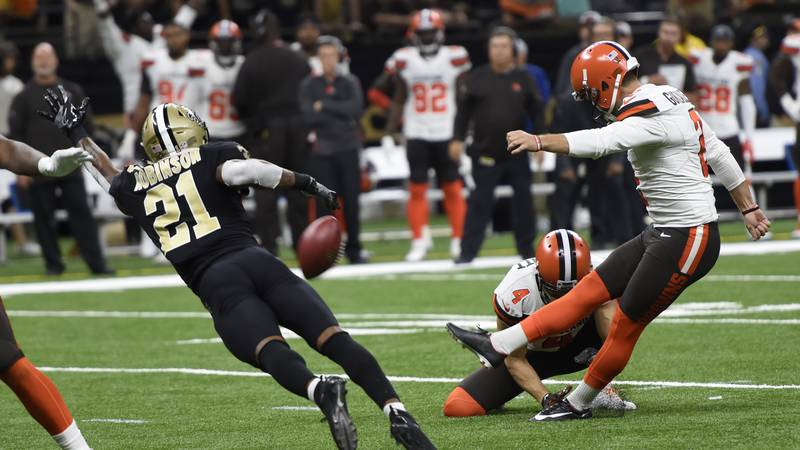 Cleveland Browns kicker Zane Gonzalez (2) tries for an extra point as New Orleans Saints...