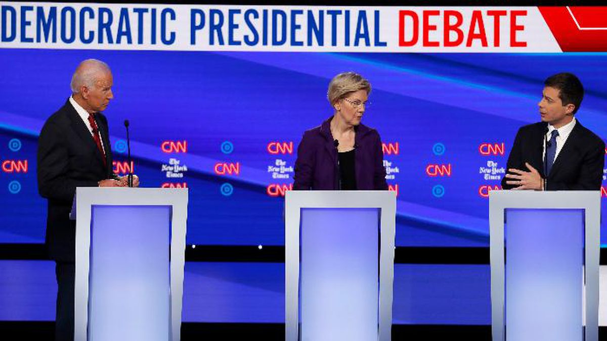 Democratic presidential candidate former Vice President Joe Biden, left, listens with Sen. Elizabeth Warren, D-Mass., to South Bend Mayor Pete Buttigieg speak during a Democratic presidential primary debate hosted by CNN/New York Times at Otterbein University, Tuesday, Oct. 15, 2019, in Westerville, Ohio. (AP Photo/John Minchillo) (Source: John Minchillo)